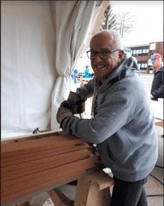 Smiling man at Rebecca Schofield Community Event