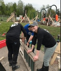 People building the playground at Rebecca Schofield Community Event